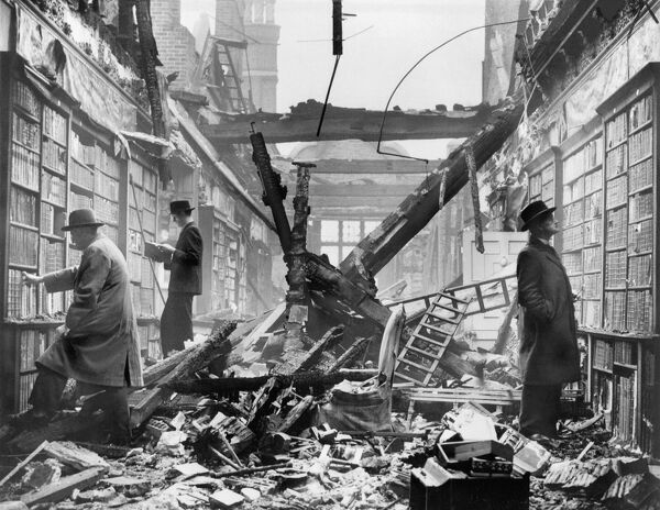 HOLLAND HOUSE, Kensington, London. An interior view of the bombed library at Holland House with readers apparently choosing books regardless of the damage