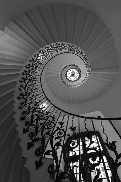 Tulip staircase, Queen's House, Greenwich. The sweeping Tulip Stairs are one of the original features of the Queen?s House. This ornate, wrought iron structure was the first geometric self-supporting spiral stair in Britain